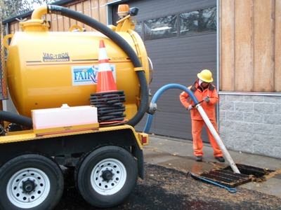 Fairview Public Works crew cleaning out a catch basin